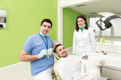 Portrait Of A Dentist , Assistant And Patient Stock Photo