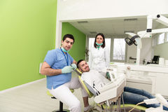 Portrait Of A Dentist , Assistant And Patient Stock Photos