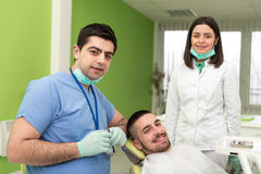 Portrait Of A Dentist , Assistant And Patient Royalty Free Stock Photos