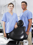Portrait Of Dentist And Nurse In Surgery Royalty Free Stock Photos