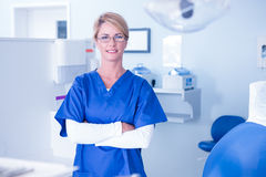 Portrait of a dentist smiling at camera with arms crossed Royalty Free Stock Photography