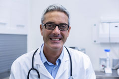 Portrait of dentist in spectacles Royalty Free Stock Photos