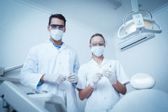 Portrait of dentists wearing surgical masks Stock Photos
