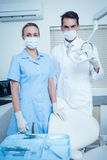 Portrait of dentists wearing surgical masks Royalty Free Stock Images