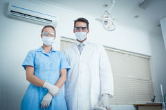 Portrait of dentists wearing surgical masks Royalty Free Stock Photos