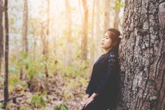 Portrait of depress and hopeless young woman calm herself. In forest at countrye Royalty Free Stock Photo