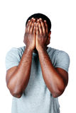 Portrait of a depressed african man. Over white background Royalty Free Stock Photo
