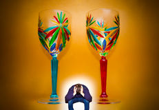 Portrait of depressed man and two wineglasses Stock Image