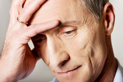 Portrait of depressed mature man touching his head Royalty Free Stock Image