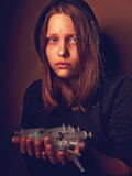 Portrait of a depressed teen girl, junkie with syringe Stock Photos