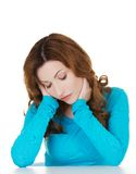 Portrait of depressed woman touching her head Stock Photos