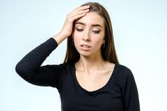 Portrait of depressed woman touching her head Royalty Free Stock Photography