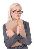 Portrait der denkenden Geschäftsfrau in den Gläsern Stockbild