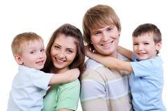 Portrait der glücklichen jungen Familie Stockbild