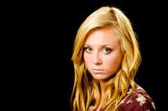 Portrait der hübschen Jugendlichen schauend traurig Lizenzfreies Stockfoto
