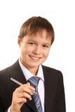 Portrait der Jugendlichjungen-Holdingfeder Stockfotografie