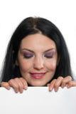 Portrait der schönen Frau mit Zeichen Lizenzfreie Stockbilder