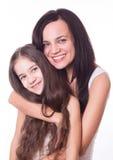 Portrait der schönen Mutter und der Tochter Stockfoto
