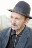 Portrait des älteren Mannes im Hut lizenzfreie stockbilder
