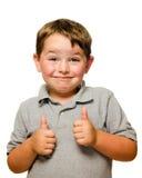 Portrait des überzeugten Kindes Daumen zeigend Lizenzfreies Stockbild
