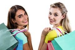 Portrait des amis féminins de sourire tenant des paniers Photos libres de droits