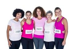 Portrait des athlètes de sourire avec des bras autour Photos libres de droits