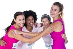 Portrait des athlètes heureux avec des bras autour Image libre de droits