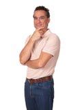 Portrait des attraktiven Lächelns mit dem Finger auf Kinn stockfoto