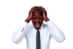 Portrait des cris africains fous d'homme d'affaires Image libre de droits