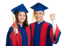 Portrait des diplômés gais Image stock