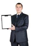 Portrait des Geschäftsmannes einen unbelegten Vorstand anhalten Lizenzfreie Stockfotografie