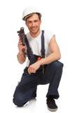 Portrait des glücklichen jungen Heimwerkers mit Hilfsmittel lizenzfreies stockbild