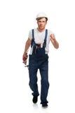 Portrait des glücklichen jungen Heimwerkers mit Hilfsmittel stockfotografie