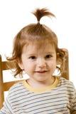Portrait des lustigen schauenden Babys mit dem langen Haar stockfoto
