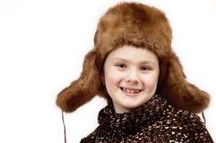 Portrait des Mädchens in einer Winterschutzkappe. Lizenzfreie Stockfotografie