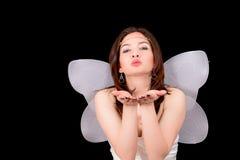 Portrait des Mädchens mit dem Flügelküssen lizenzfreie stockbilder