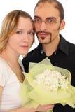 Portrait des Mannes in den Gläsern und im blonden Mädchen der Schönheit Stockfotografie
