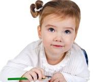Portrait des netten kleinen Mädchens mit einem Bleistift Lizenzfreie Stockfotografie