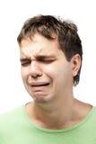 Portrait des schreienden jungen Mannes getrennt auf Weiß Stockfotografie