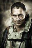 Portrait des stattlichen Mannes des traurigen Soldaten Stockbild