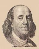 Portrait des US-Staatsmannes, -erfinders und -diplomaten Benjamin Franklin, wie er auf hundert Dollarscheingegenstücck schaut S P Lizenzfreie Stockbilder