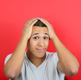 Portrait of desperate man against red background Stock Images