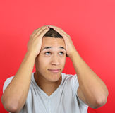 Portrait of desperate man against red background Stock Photo
