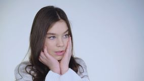 Portrait of desperate young beautiful girl leans on hands and thinking stock video