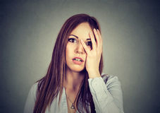 Portrait of desperate young worried woman stock image