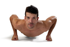 Portrait of determind shirtless player exercising planks