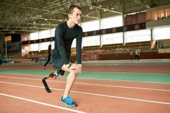 Handicapped Sportsman Stretching royalty free stock images