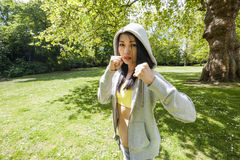 Portrait of determined fit woman practicing boxing at park Stock Image