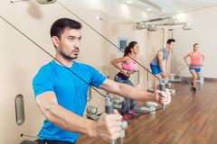 Determined young man exercising with resistance bands royalty free stock image
