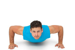 Portrait of a determined man doing push ups Royalty Free Stock Photos